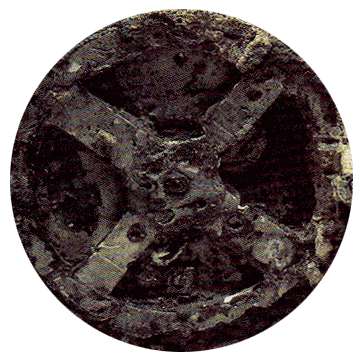 A circled X, part of the Antikythera Device found in Athens, scanned in from magazine