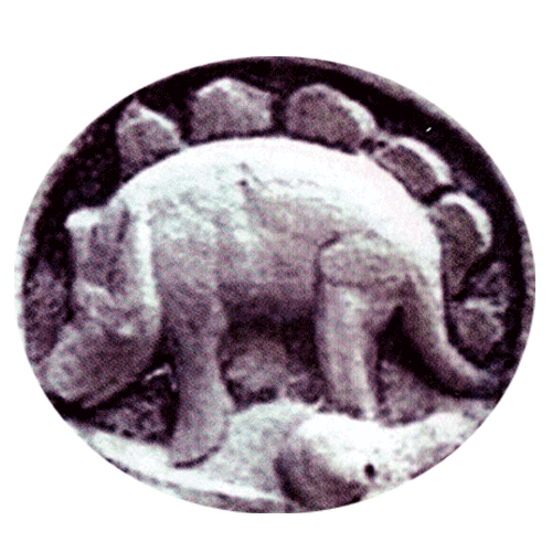 What looks like a stegosaurus, shot taken at a temple in Cambodia, scanned in from a magazine
